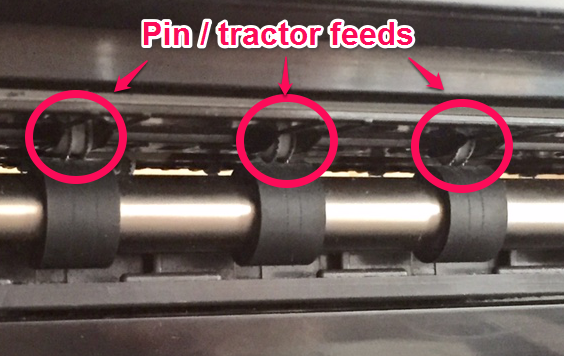 Example of pin or tractor feeds on inkjet printer